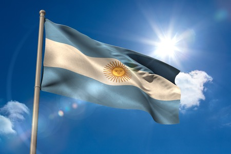 argentina flag: Argentina national flag on flagpole on blue sky background