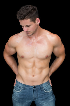blue jeans: Muscular man posing in blue jeans on black background