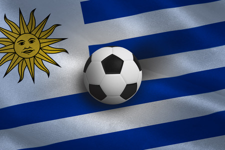 Black and white football against uruguay flag background photo