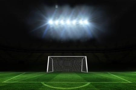 goalpost: Digitally generated football pitch and goal under spotlights Stock Photo