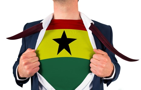 Businessman opening shirt to reveal ghana flag on white background photo