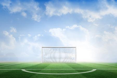 goalpost: Digitally generated football pitch under blue sky Stock Photo