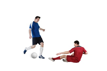 Football players tackling for the ball on white background Stock Photo - 29067145