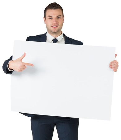 Happy businessman showing card to camera on white background photo