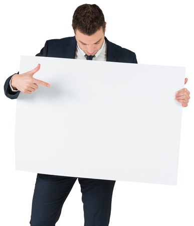 Businessman showing card to camera on white background photo
