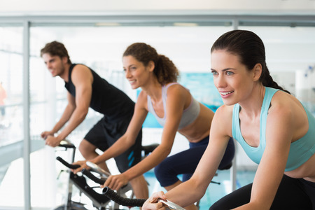 Fit people in a spin class at the gym photo