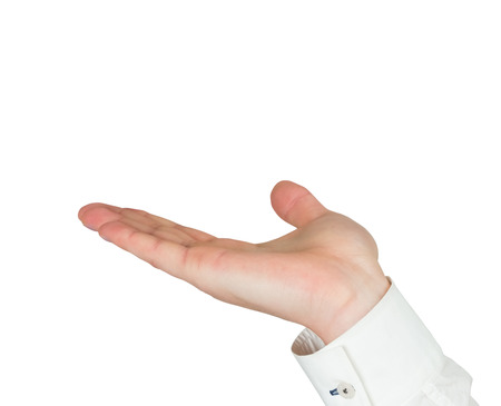 Businessman holding hand out in presentation on white background Stock Photo
