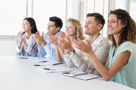 Casual business team clapping at presentation in the office Stock Photo
