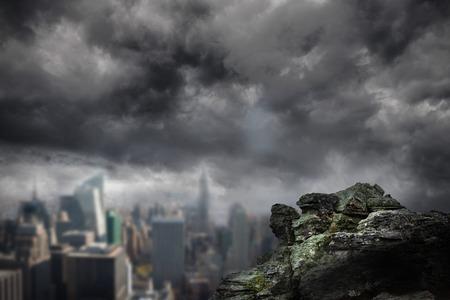 dark city: Digitally generated large rock overlooking dark city