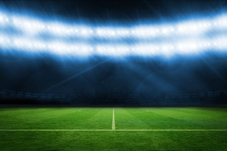 football pitch: Digitally generated football pitch under blue lights Stock Photo