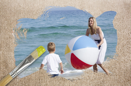 Composite image of mother and son on the beach against surface with paintbrushes photo
