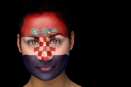 Composite image of croatia football fan in face paint against black photo