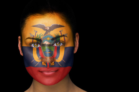 Composite image of ecuador football fan in face paint against black photo