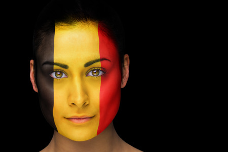 Composite image of belgian football fan in face paint against black photo
