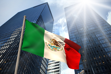 Mexico national flag against low angle view of skyscrapers Фото со стока - 29073186