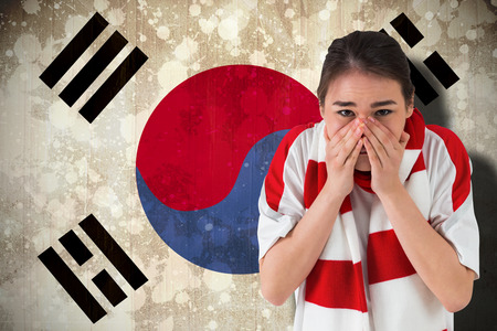 Nervous football fan looking ahead against south korea flag photo
