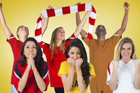 Composite image of football fans against yellow vignette photo