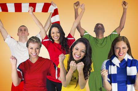 Composite image of football fans against orange vignette photo