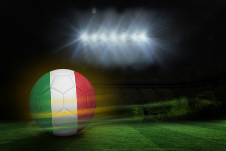 Football in italy colours against football pitch under spotlights photo
