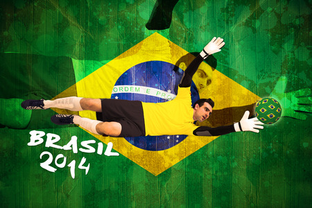 Goalkeeper in yellow making a save against brazil flag in grunge effect photo