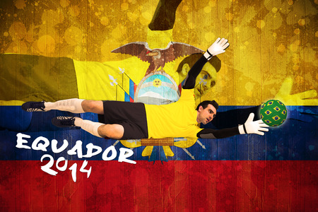 making a save: Goalkeeper in yellow making a save against ecuador flag in grunge effect Stock Photo