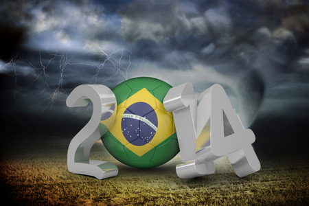 Brazil world cup 2014 against stormy sky with tornado over field photo