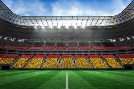 stadium lights: Digitally generated german national flag against large football stadium Stock Photo