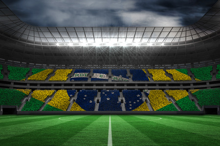football fan: Digitally generated brazilian national flag against large football stadium