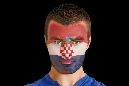 Composite image of serious young croatia fan with facepaint against black photo