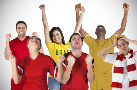 Composite image of football fans and players against white background with vignette photo