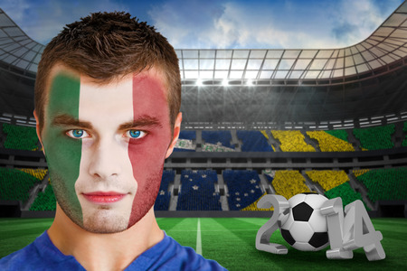 Composite image of serious young ivory coast fan with face paint against large football stadium photo
