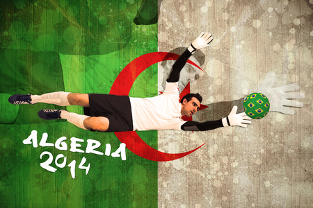 Goalkeeper in white making a save against algeria flag in grunge effect photo