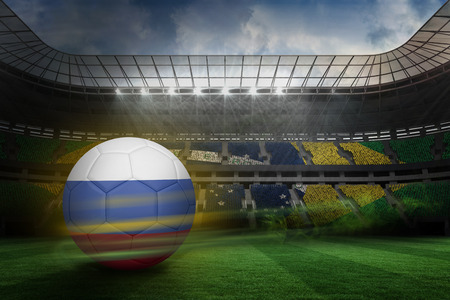 fast pitch: Football in russia colours against large football stadium with brasilian fans