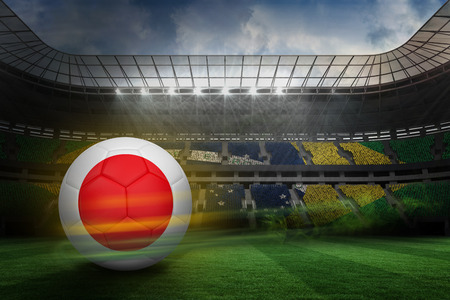 Football in japan colours against large football stadium with brasilian fans photo