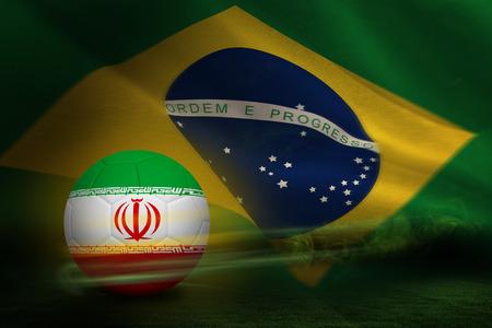 Football in iran colours against brazilian flag waving photo