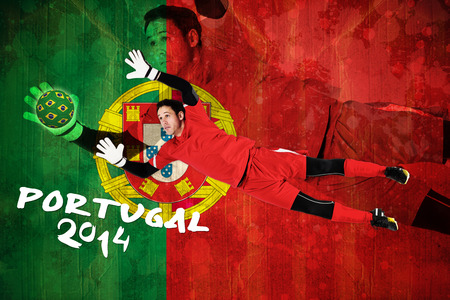 Fit goal keeper jumping up against portugal flag in grunge effect photo
