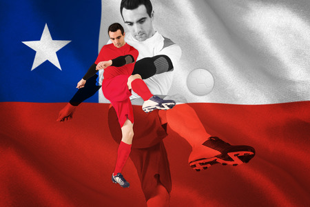 Football player in red kicking against digitally generated chile national flag photo