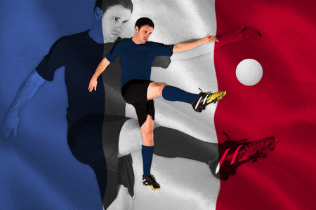 Football player in red kicking against digitally generated france national flag photo