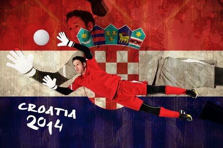Fit goal keeper jumping up against croatia flag in grunge effect photo