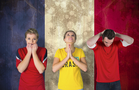 Composite image of various football fans against france flag in grunge effect photo