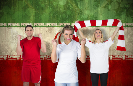 Composite image of various football fans against iran flag in grunge effect photo