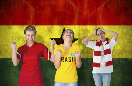 Composite image of various football fans against ghana flag in grunge effect photo