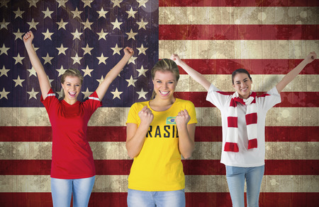 Composite image of various football fans against usa flag in grunge effect photo