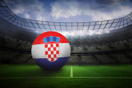 Football in croatia colours in large football stadium with lights photo