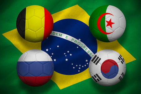 Composite image of group h footballs for world cup against digitally generated brazilian national flag photo
