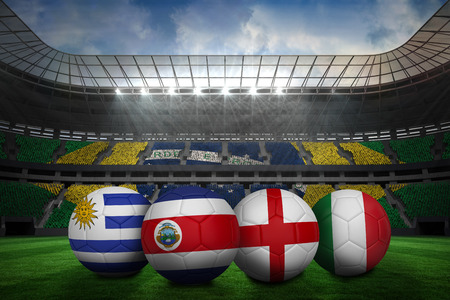 Composite image of footballs in group d colours for world cup against large football stadium with brasilian fans Stock Photo - 29077623