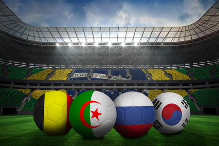 Composite image of footballs in group h colours for world cup against large football stadium with brasilian fans photo