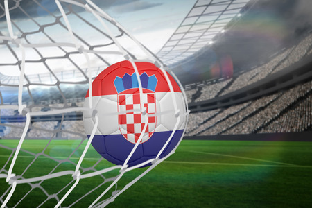 Football in croatia colours at back of net against large football stadium with lights photo