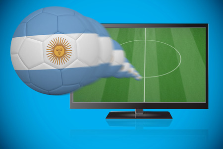 Football in argentina colours flying out of tv against blue background with vignette photo
