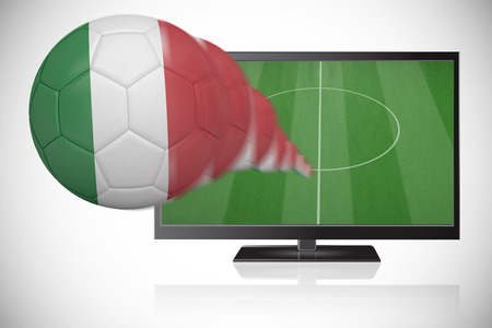 Football in italy colours flying out of tv against white background with vignette photo